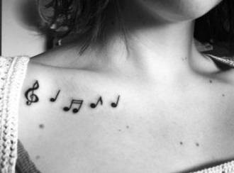 chest-tattoos-music-notes-women