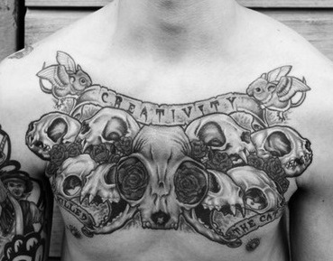 chest-tattoos-skull-scroll