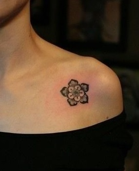 chest-tattoos-tudor-rose-women