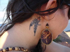 ear-tattoo-behind-feather