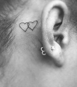 ear-tattoo-behind-hearts