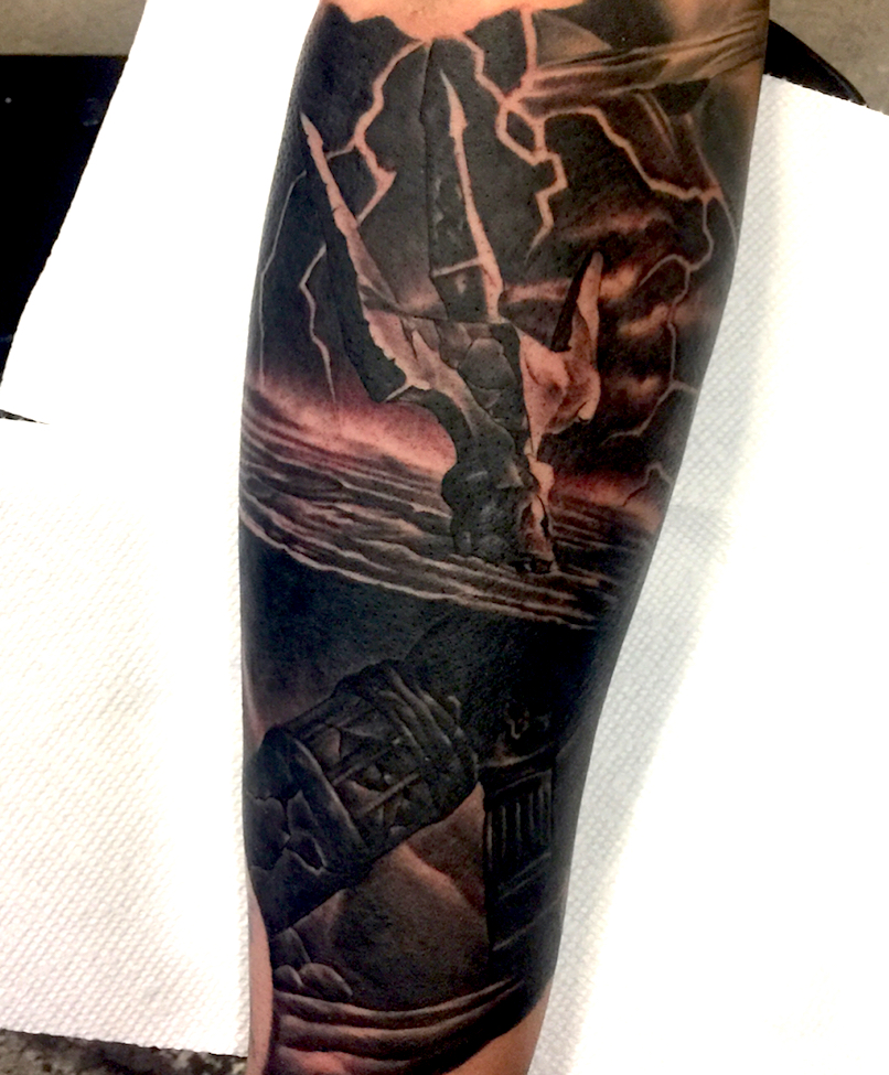 Poseidon tattoo on forearm by Chris Beardsley