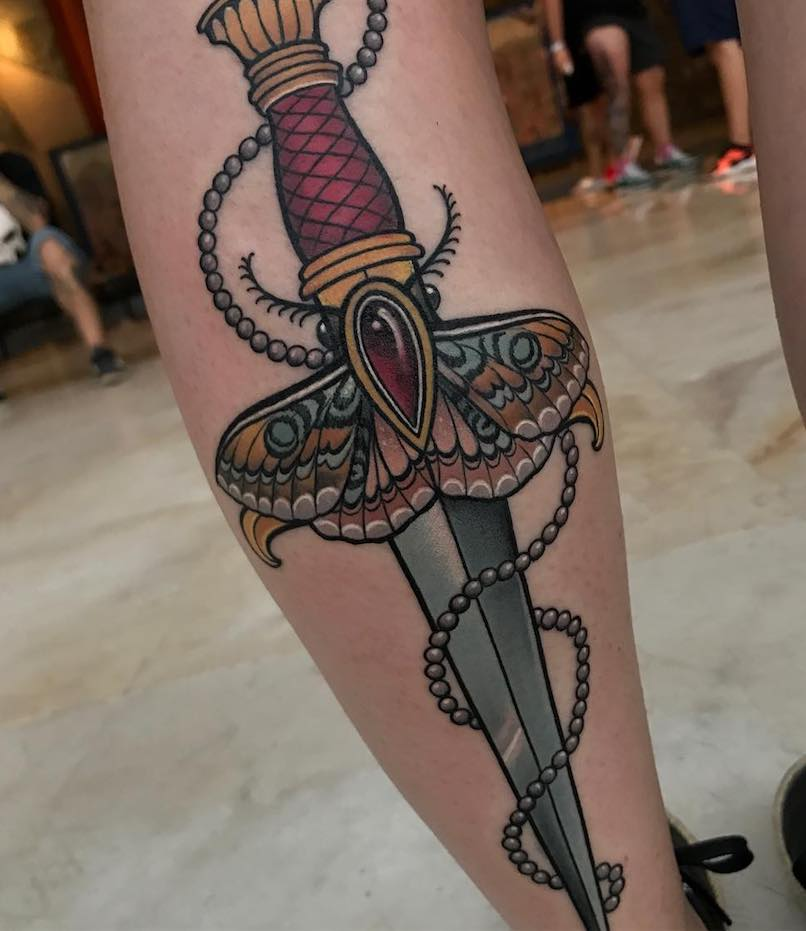 butterfly and dagger tattoo by Lara Hallon