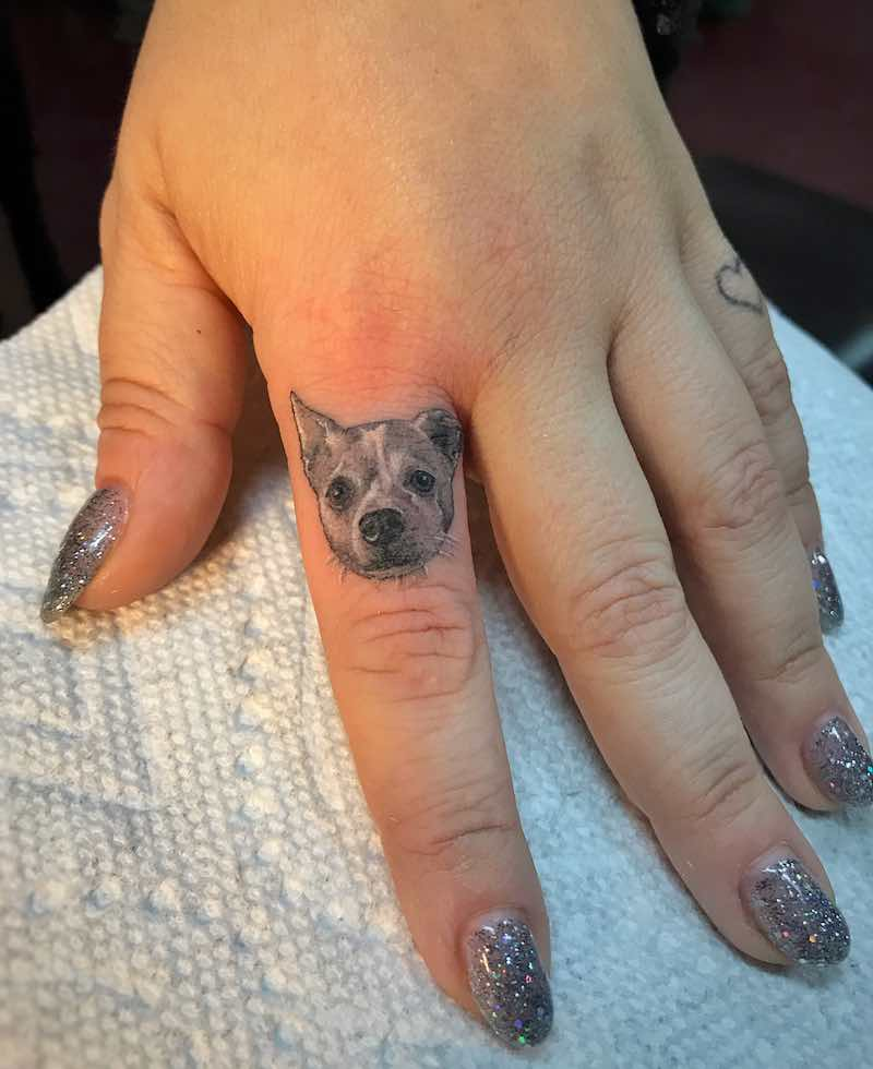 Small Dog Finger Tattoo by Ben Grillo